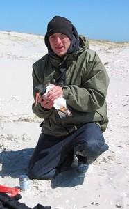 Grodsky holding a bird