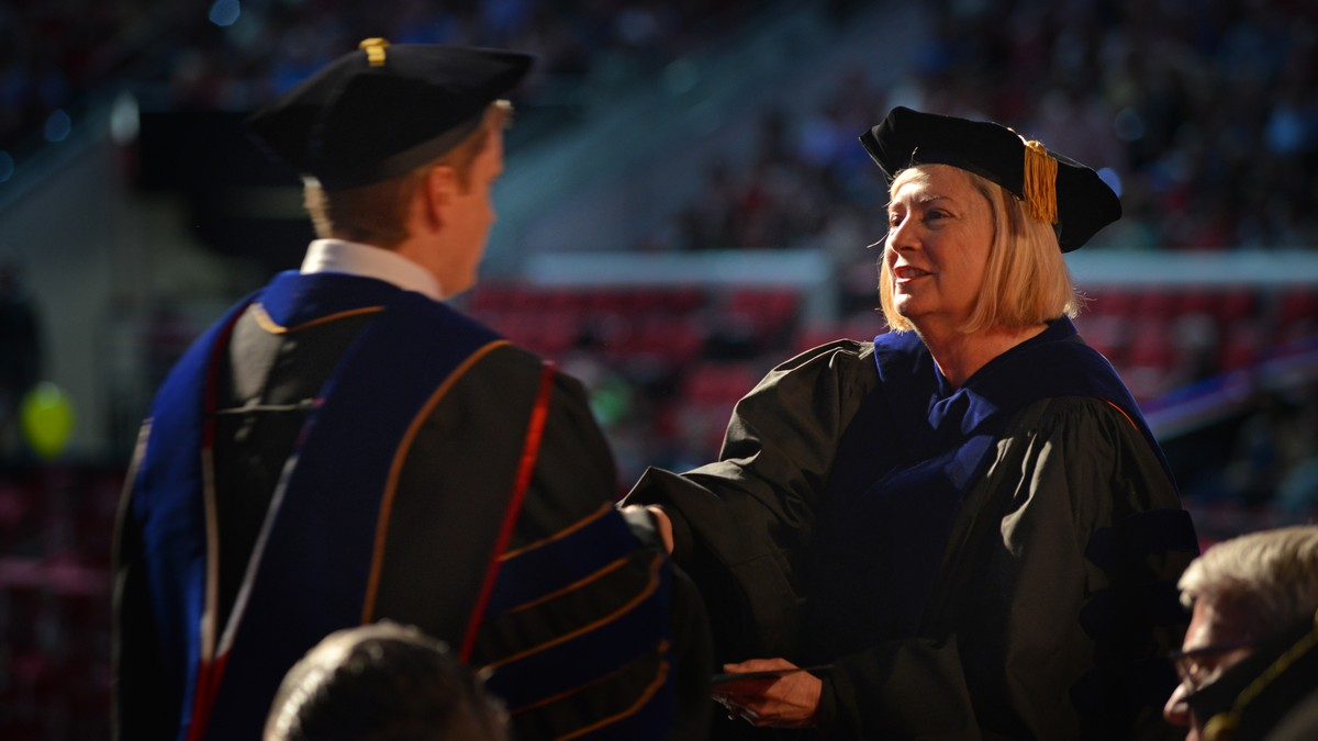 Dean Grasso shakes graduate's hand