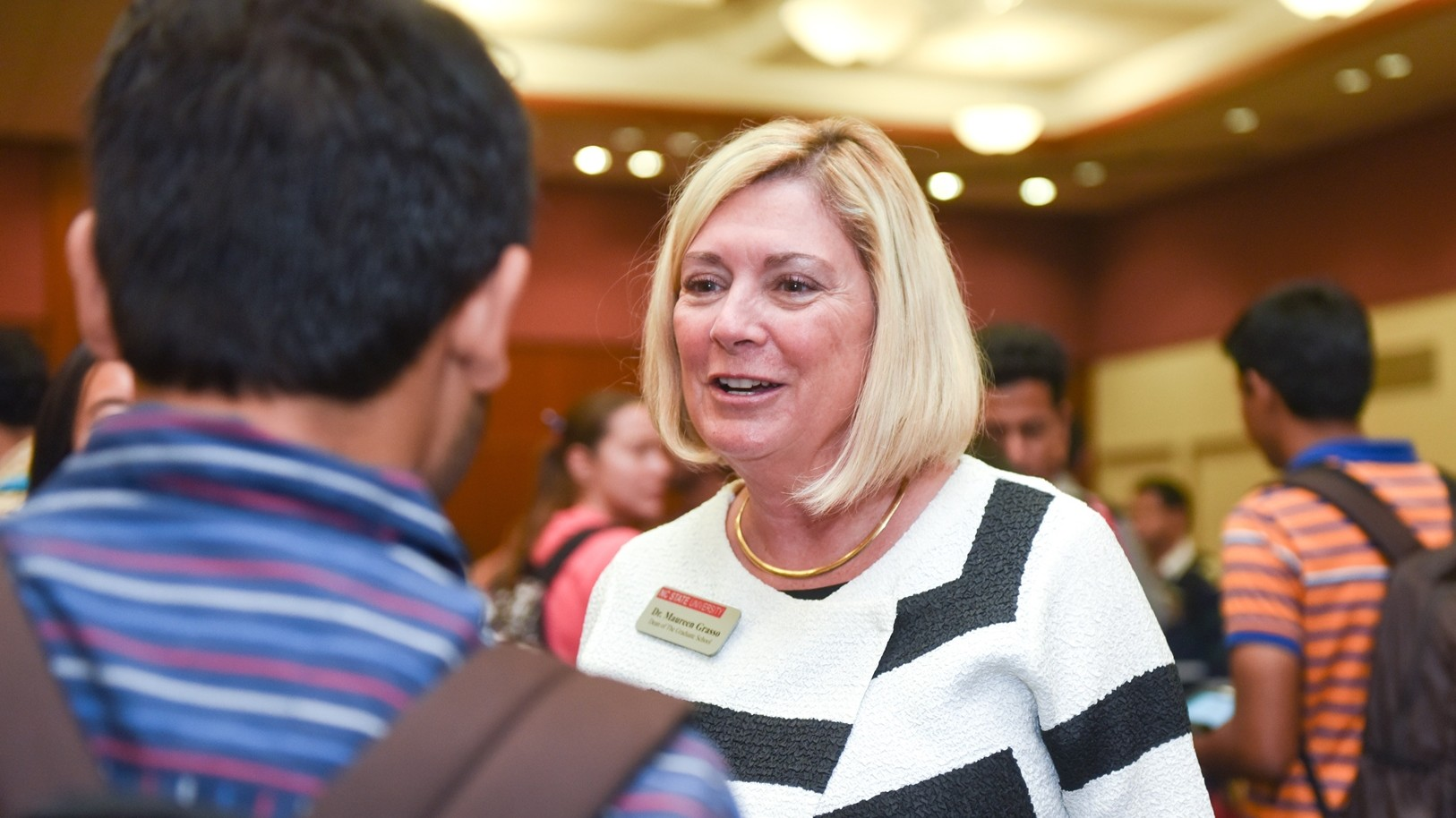 Maureen Grasso talks with student at orientation