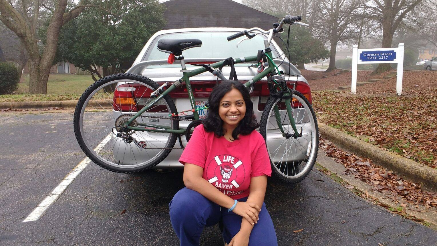 Haritha besid her car and bike