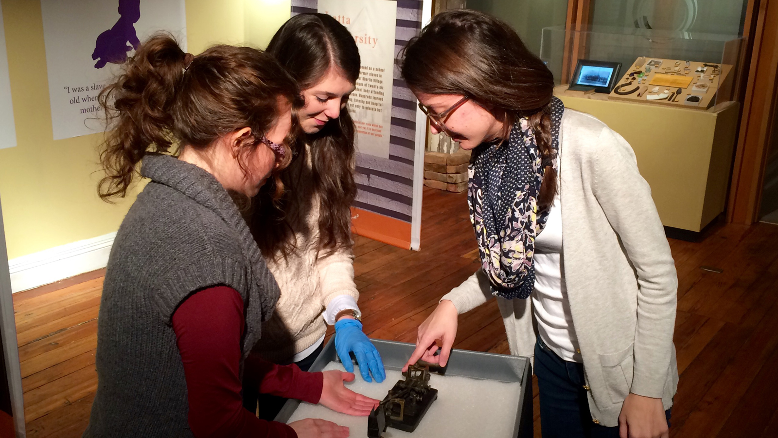 Students talk with museum patron