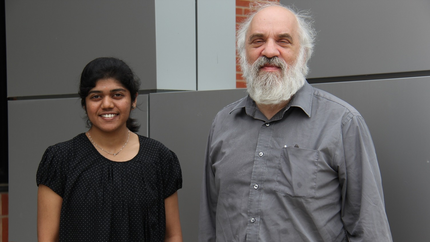 Sindhu and David in front of Grad School