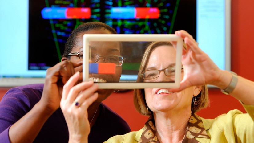 two women look at screen