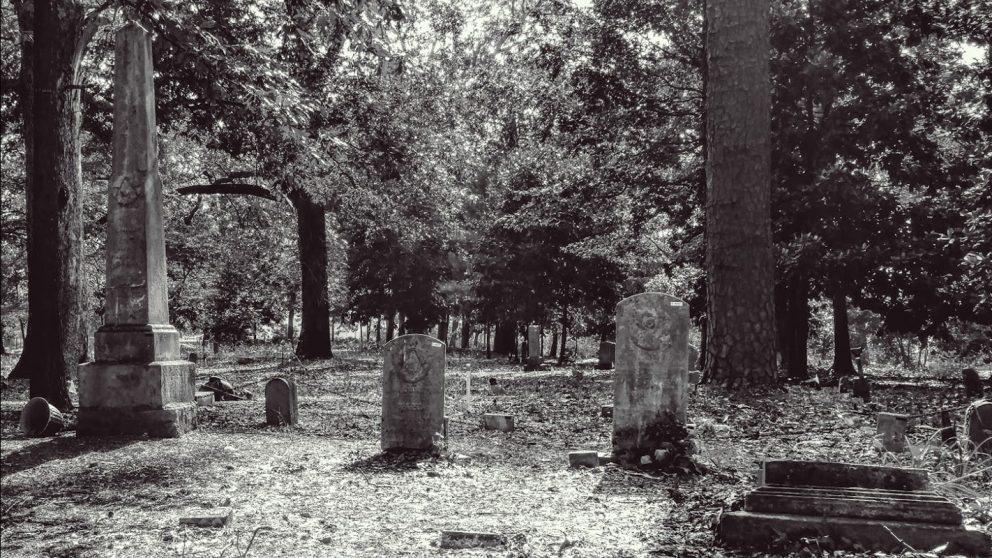 black and white photo of headstones