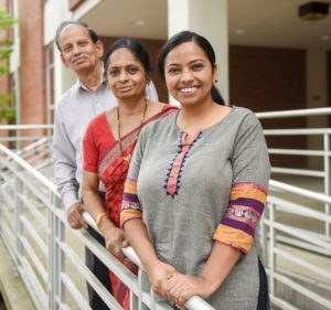 Haritha Malladi stands with her parents