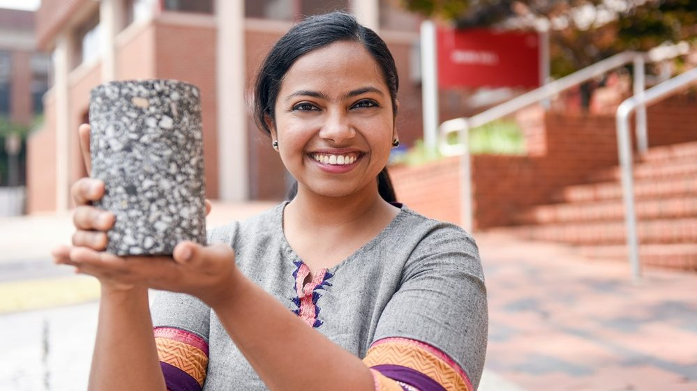 Haritha holds a block of asphalt