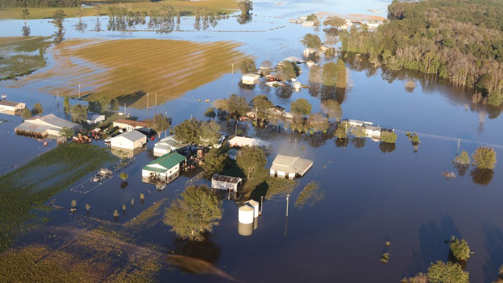 flood waters overcome farm