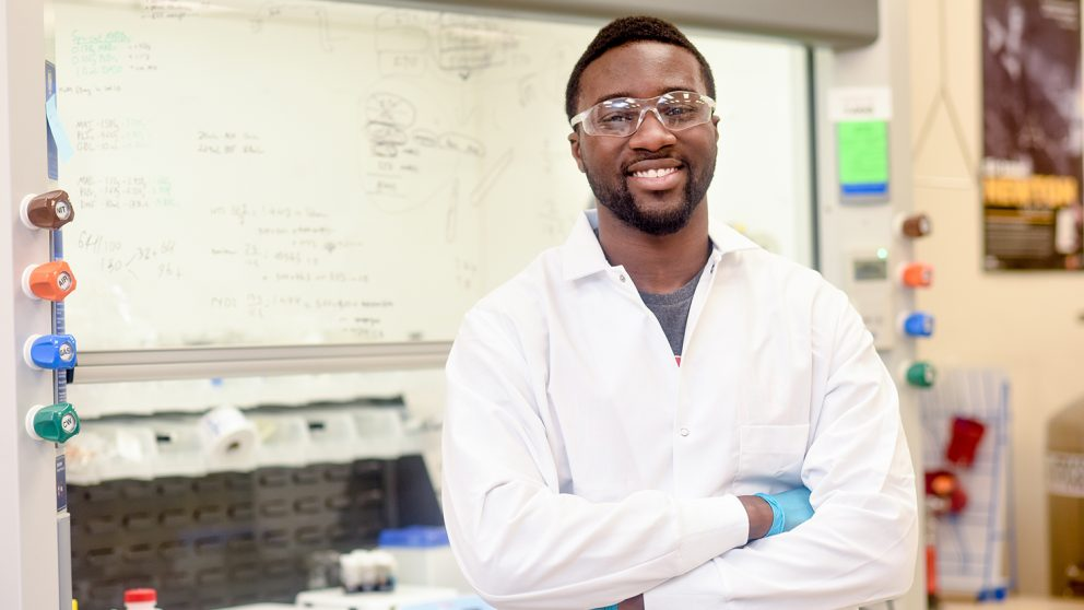 Stephen Amoah in lab coat