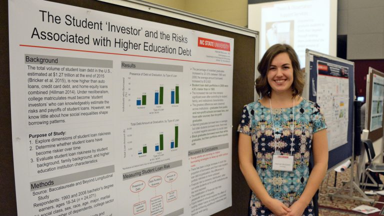 Hannah McQueen and her research poster