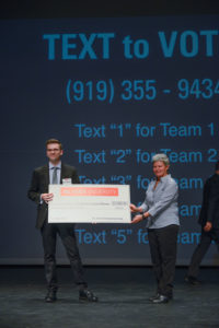 Majeski holds large check