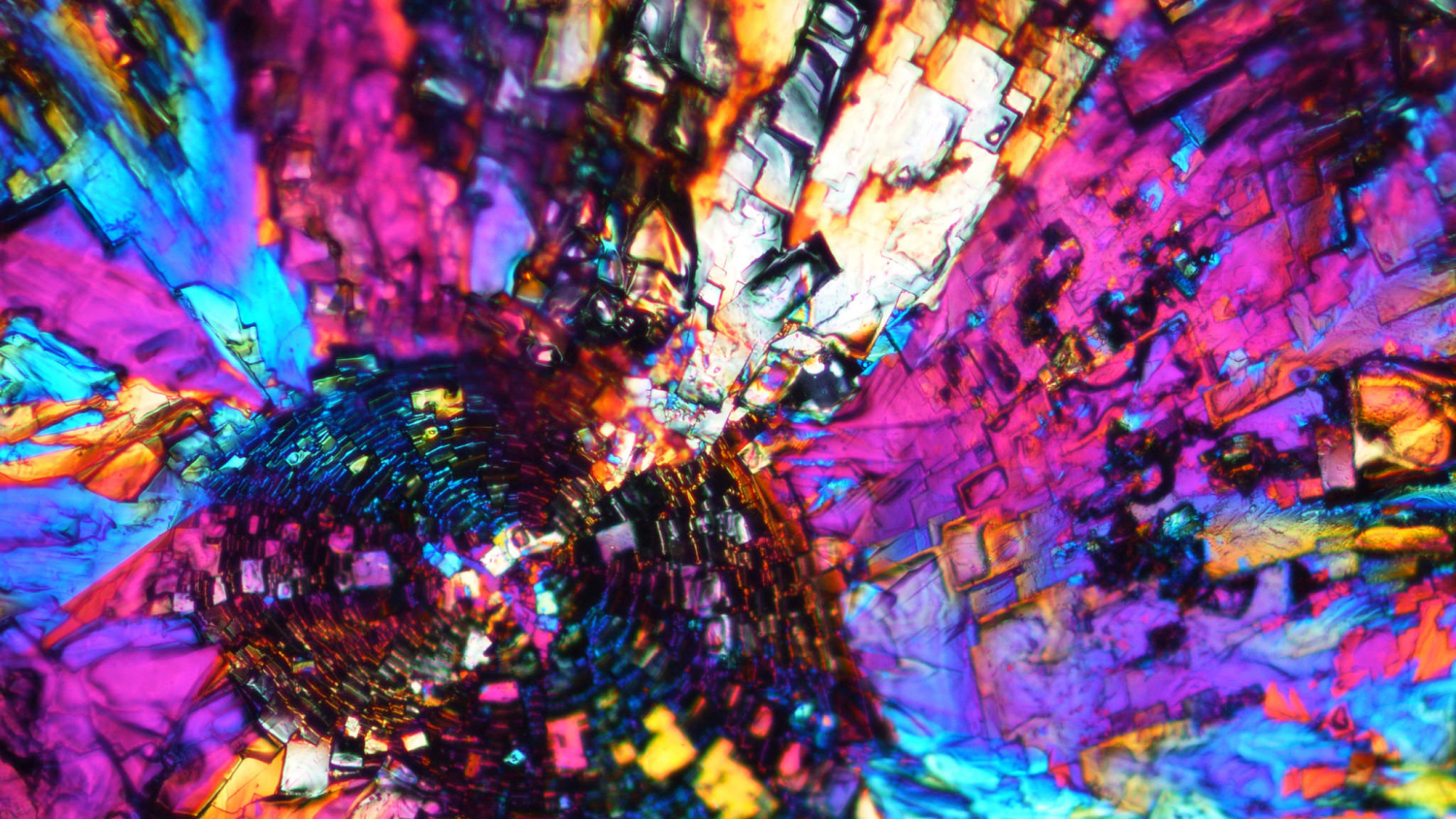 unedited polarized light microscope image shows the crystal formation of a special type polyhedral oligomeric silsesquioxane (POSS) solvent-casted with chloroform.
