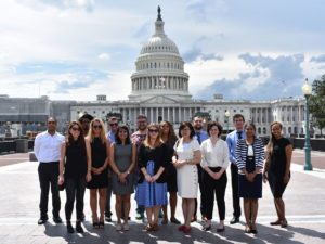 group standing in front of Capitol