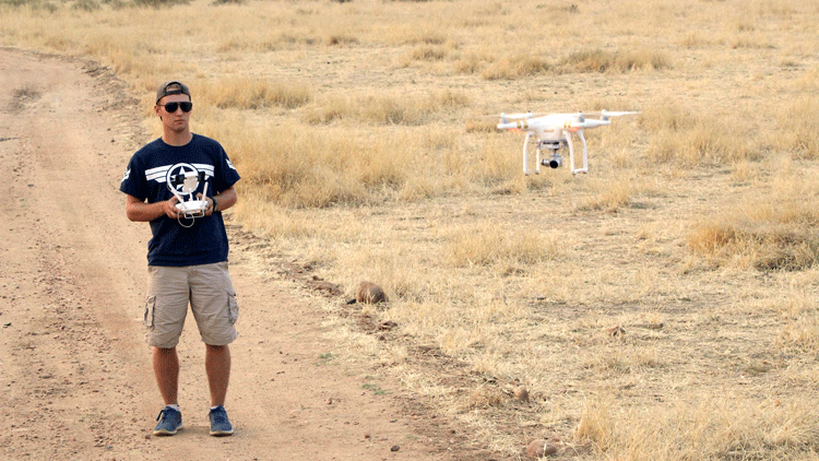 student operating drone