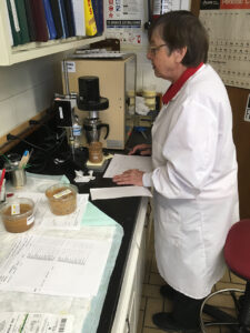 Jessie Rivers in the laboratory, working on a piece of equipment